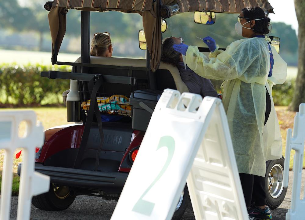 Medical volunteers perform COVID-19 test swabs