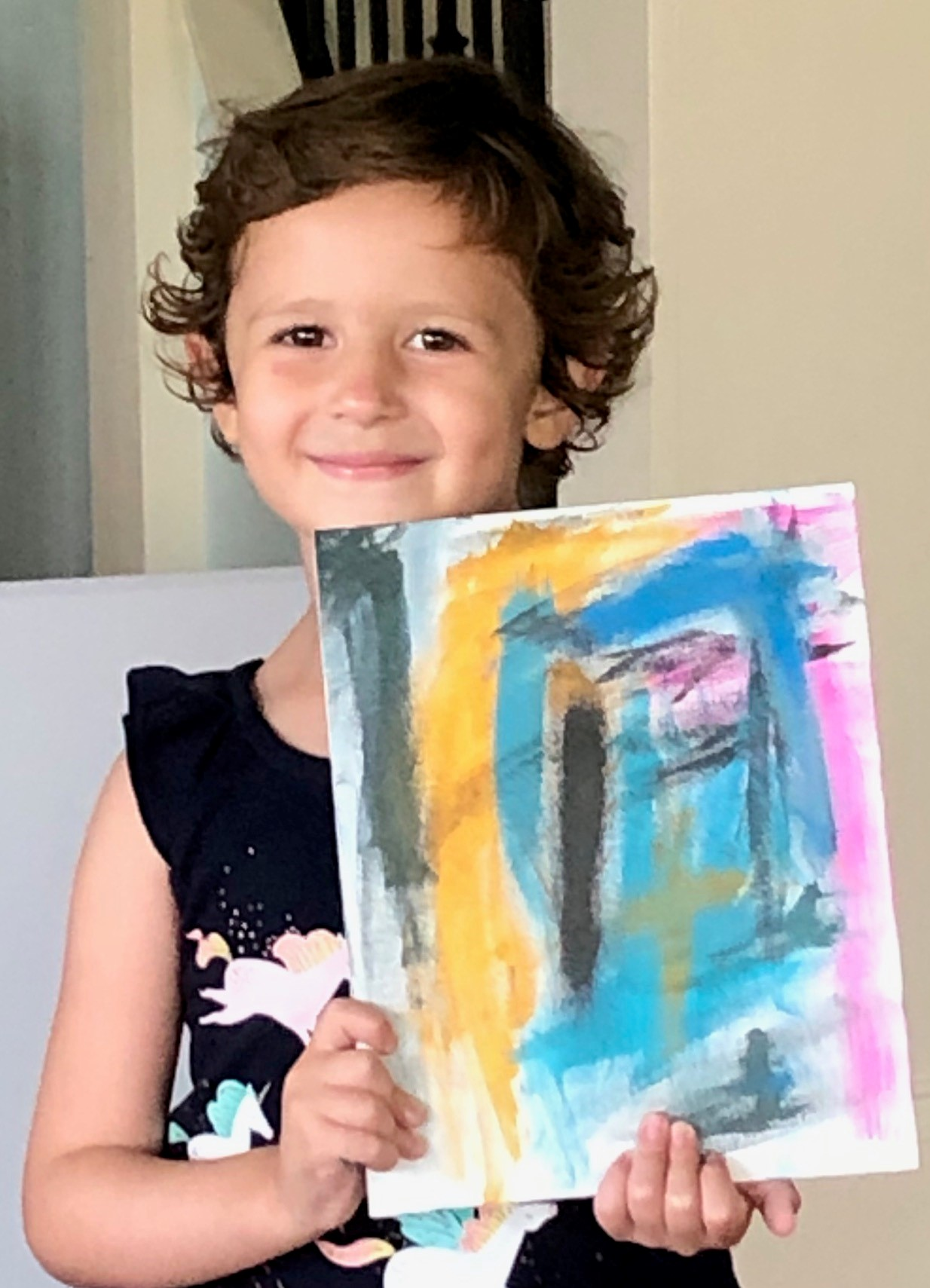 Josie Macchio poses with a painting