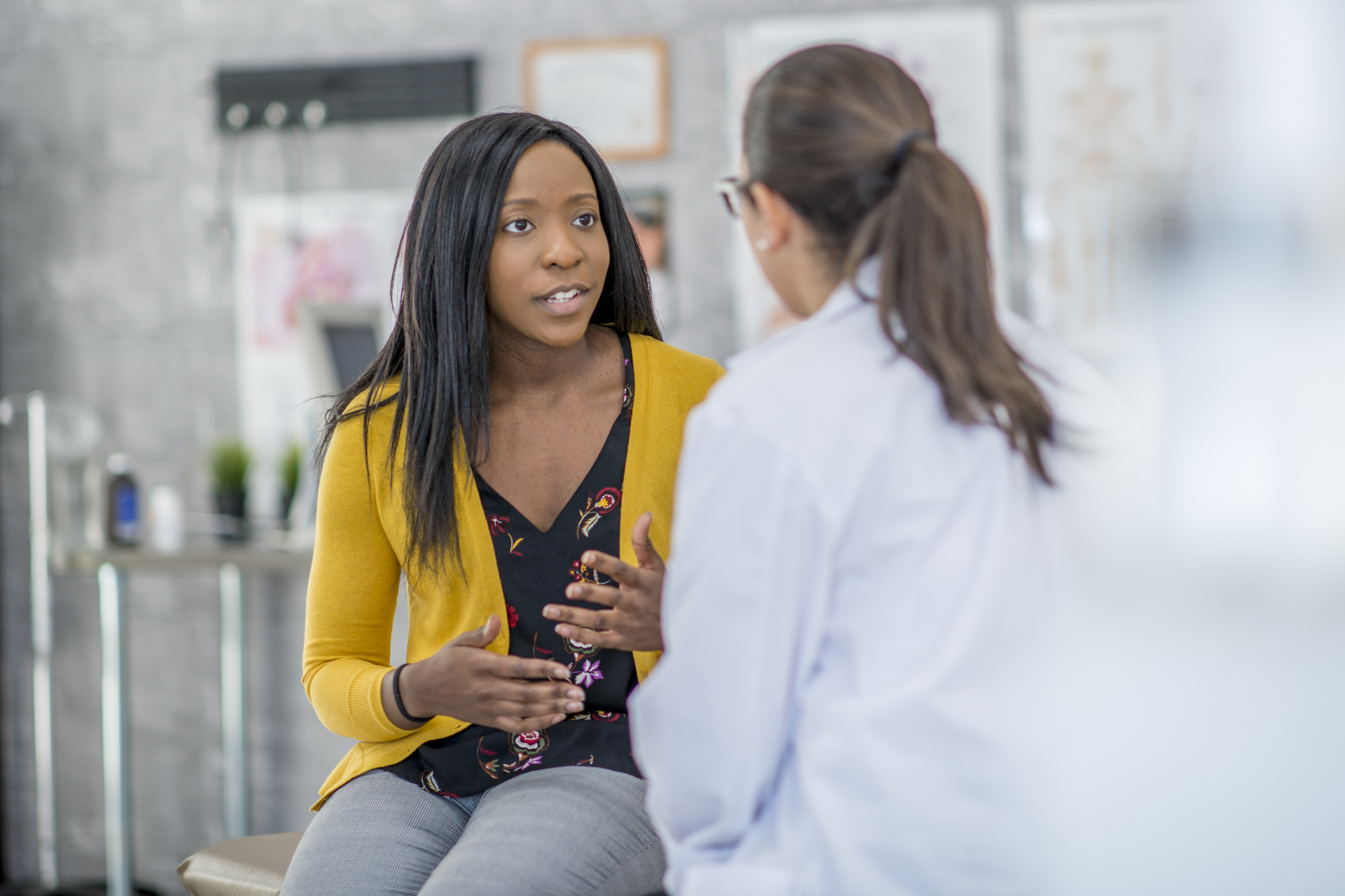 woman talks to her provider while sitting