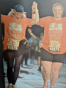Judy Jones and daughter Debi cross the finish line of the Disney Fall Feast 5K in November 2018. (Photo courtesy of Judy Jones.)