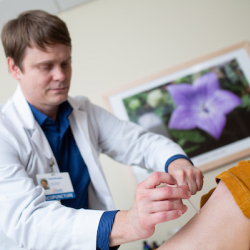 A UF Health provider conducts acupuncture on a patient