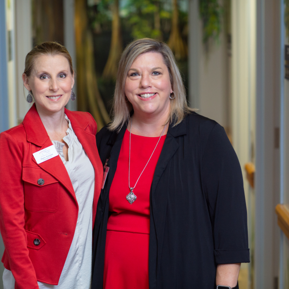 Sherry Kitchens (left), president and CEO of the Child Advocacy Center of Gainesville, and Stephanie Cox, assistant director of the UF Child Protection Team, stand together at the University of Florida Health Pediatrics – Gerold L. Schiebler CMS Center, where the two groups have offices.