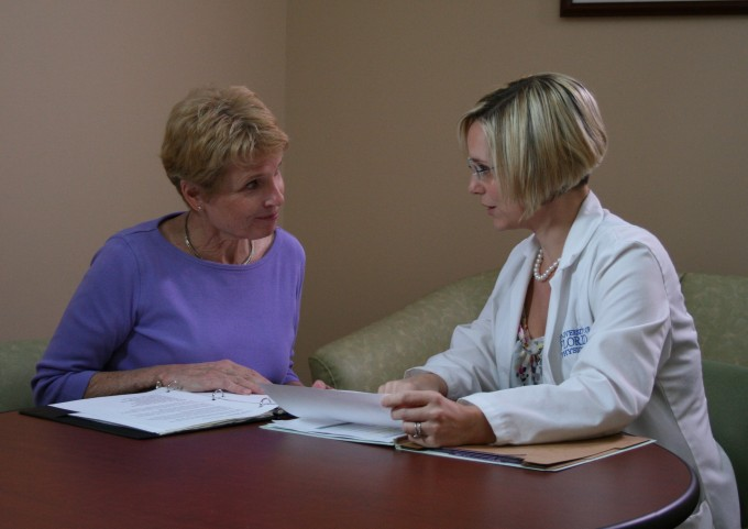 Doctor and patient talking at consultation