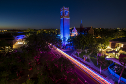 The 11-story Century Tower is lit in blue to honor the more than 11,000 UF Health Shands employees in Gainesville and their UF Health colleagues throughout the region. Credit: Brian Sandusky