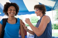 The UF Student Health Care Center is hosting a mass flu vaccination event on its front lawn. UF student Raquelle Newman recieved her flu shot from Lily Hummer, R.N., and was among the 500 students who stopped for a free flu shot.