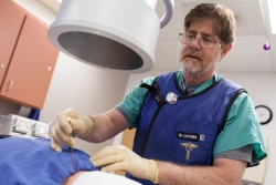 William S. Jacobs, M.D., uses a new water-cooled radiofrequency system to treat a patient. Photo by Jesse Jones