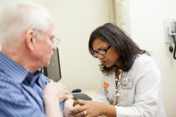 Alpa Desai, D.O., visits with a patient at UF&Shands Family Medicine at Jonesville.