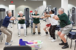 LIFE study participants practice squats at the University of Florida, which mimic rising out of a chair and are important in maintaining mobility and independence in older adults. The study, which will be released May 27, examined how physical activity affects the mobility of adults aged 70-89.