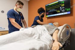 UF nursing students Serenity McNair and Jacob Zoltek use a high-fidelity patient simulator to learn and practice skills in the newly renovated Thomas M. and Irene B. Kirbo Innovation and Learning Laboratory.