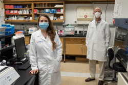 Dr. Leah Reznikov and Dr. David Ostrov are shown in Reznikov's lab on June 5. (Photo by Jesse Jones)