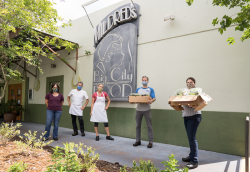 Dr. Amy Stone, Chef Bert Gill, Cassie Stich, Troy Weindorf and Claudine Chegini outside Mildred's Big City Food.
