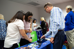 Participants in a UF Diabetes Institute program to improve access to care for underserved children and adults living with Type 1 diabetes look at technology such a blood-glucose monitors during a recent kickoff event at the UF College of Public Health and Health Professions.