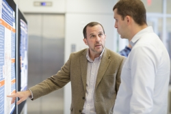 Chris Delcher, Ph.D., left, is an assistant professor in the University of Florida College of Medicine's department of health outcomes and policy.