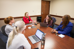 UF College of Nursing undergraduate students in the EMBRACE program participate in a faculty mentoring session with Associate Professor Jeanne-Marie  Stacciarini, Ph.D., R.N., FAAN, and Clinical Assistant Professor Paula Delpech, Ph.D., R.N., APRN.
