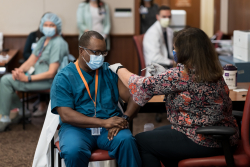 """By taking this vaccine, all of us — literally all of us — will have an opportunity to alleviate suffering and save lives,"" said Joseph A. Tyndall, M.D., M.P.H., a practicing board-certified emergency medicine physician who regularly sees patients and who is also the associate vice president for strategic and academic affairs for UF Health and the interim dean of the UF College of Medicine."