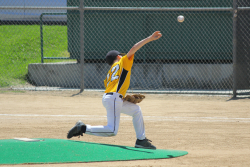 A youth baseball players throws during a game. UF Health physicians note that even youngsters can encounter arm overuse injuries requiring surgery, just like college and major league pitchers. (Getty Images)