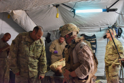 Mark Jackson, D.O., a part-time UF Health Shands Hospital emergency room doctor, participates in a medical drill in Iraq during a recent deployment as an Army reservist.