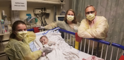 Karen Wright (left), Londyn Wright, nurse practitioner Kara Godwin Wild and Barry Byrne, M.D., Ph.D., in the pediatric intensive care unit at University of Florida Health Shands Children's Hospital on June 7 — Londyn's gene therapy infusion day. Byrne is the associate chair of pediatrics and director of the Powell Gene Therapy Center at the University of Florida. (Rossana Passaniti/UF Health)
