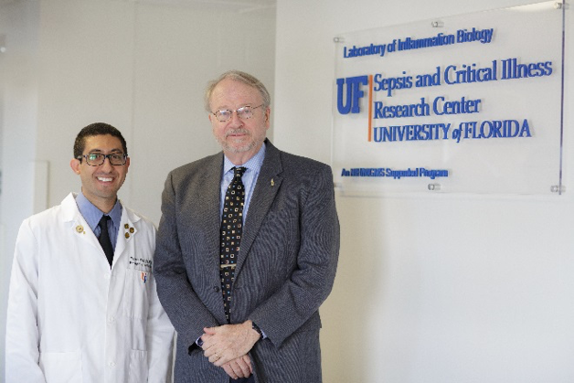 Faheem Guirgis, an assistant professor in the department of emergency medicine and the CTSI's first KL2 scholar from the UF Health Jacksonville campus, with UF Health Executive Vice President for Research and Education Thomas A. Pearson, who directs the CTSI Translational Workforce Development Program and serves as principal investigator for the KL2 program. Their abstract about UF's KL2 program was selected for presentation at the national CTSA meeting in October 2016. Photo Credit: Mindy Miller