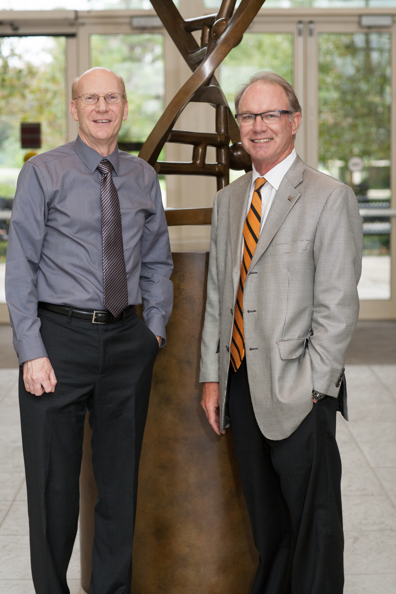 Patrick Concannon, Ph.D., the new UFGI director, welcomes William E. Evans, Pharm.D., director and CEO of St. Jude Children's Research Hospital, the keynote speaker at Florida Genetics 2013.