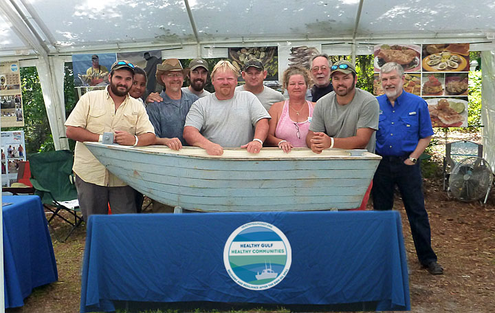 Drs. Morris (EPI director, far right) and Kane (Aquatic Pathobiology Laboratory director, third from left) are joined by graduate students and seafood workers from Apalachicola and Steinhatchee at the 2013 Florida Folk Festival. Their outreach exhibit highlighted the Healthy Gulf Healthy Communities project, and showcased heritage oyster and stone crab fisheries with demonstrations and tastings for more than 20,000 festival-goers.