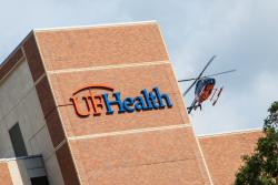 UF Health ShandsCair flys over UF Health Shands Hospital