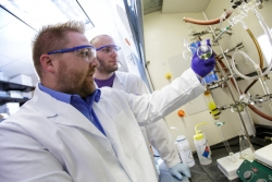 Dr. Rob Huigens, left, leads a team of UF researchers that developed potent new compounds that can kill dangerous bacterial biofilms present in recurring and chronic bacterial infections.