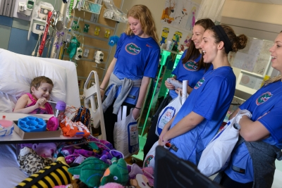 Coach Mary Wise and the UF Volleyball Team brought joy to patients at UF Health Shands Children's Hospital during their annual visit the day before Thanksgiving. Each Thanksgiving season for the past 23 years, the team has spent time with patients singing songs, signing autographs and doing the Gator Chomp.