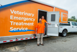 Brandi Phillips and Dr. Larry Garcia of the UF Veterinary Emergency Treatment Service, stand with the new truck and trailer rig donated to UF VETS by Banfield Foundation and PetSmart Charities. Phillips is UF VETS' technical rescue director, and Garcia is its medical director. (Photo by Jesse Jones)