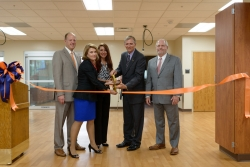 Shown cutting the ribbon at an event held Aug. 4 to celebrate completion of the University of Florida College of Veterinary Medicine's new clinical skills laboratory are, from left to right, Dr. David Guzick, Dr. Pamela Ginn, Ariel Robelen, Dr. James W. Lloyd and Dr. Jack Payne. (Photo by Jesse Jones)