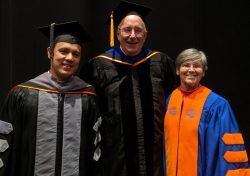 Dr. Michael Wong, Dr. Rob MacKay and Dr. Cynda Crawford, winners of the UF College of Veterinary Medicine's Distinguished Awards in the Special Service, Distinguished Service and Alumni Achievement-DVM categories, respectively, are shown May 25 during the college's commencement activities. Not pictured is Dr. Lucy Keith-Daigne, winner of the Alumni Achievement-M.S./Ph.D. category.