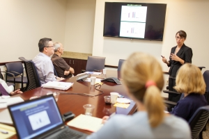 Shannon Boye, Ph.D., presents in front of colleagues and representatives from Genzyme. Jesse Jones
