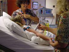 Child getting an arm ultrasound for a PICC line