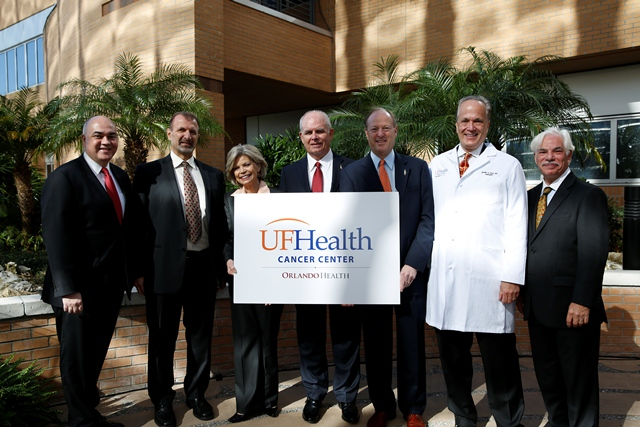 From left, Dr. Wayne Jenkins, president of Orlando Health Physician Partners, Dr. Jamal Hakim, Interim President of Orlando Health and Orlando Health Board Chair Dianna Morgan join UF President Bernie Machen, Dr. David S. Guzick, UF senior vice president senior vice president for health affairs and president of UF Health, Dr. Mark Roh, president of the UF Health Cancer Center at Orlando Health and Timothy M. Goldfarb, CEO of UF Health Shands