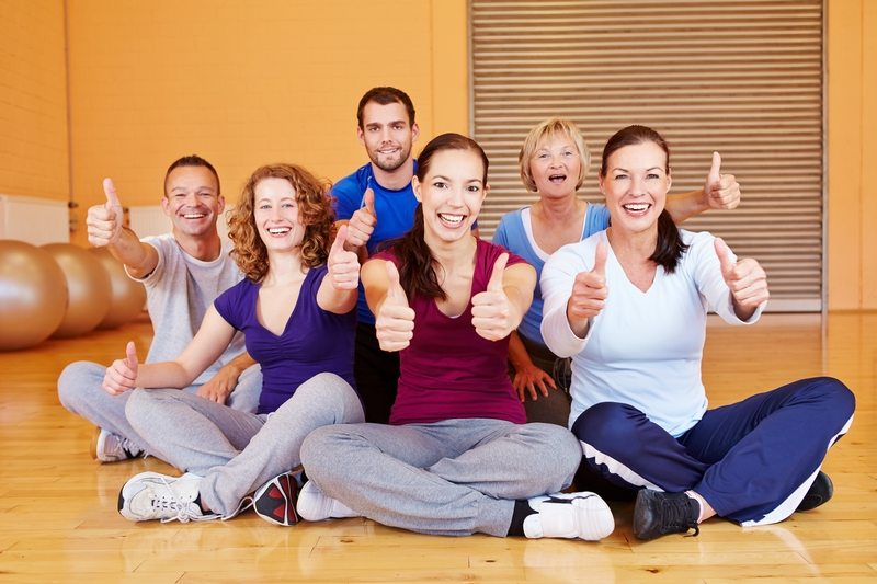 Work out group with thumbs up