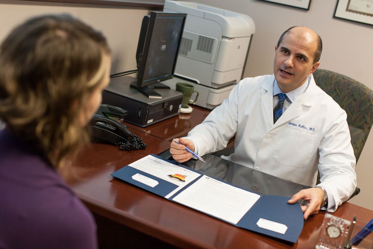 Dr. Kallas talking to patient
