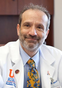 Dr. Paul Okunieff, M.D.
