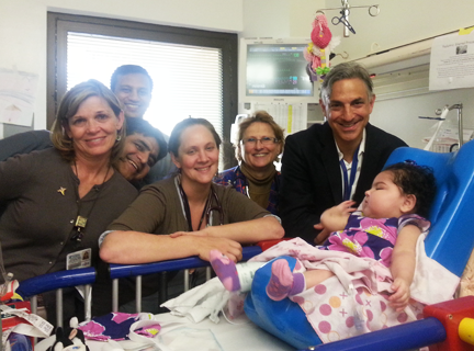 Izabella Neira is photographed with her team of nurses and physicians at the UF Health Congenital Heart Center.