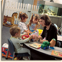 children playing in a Shands playroom with a volunteer