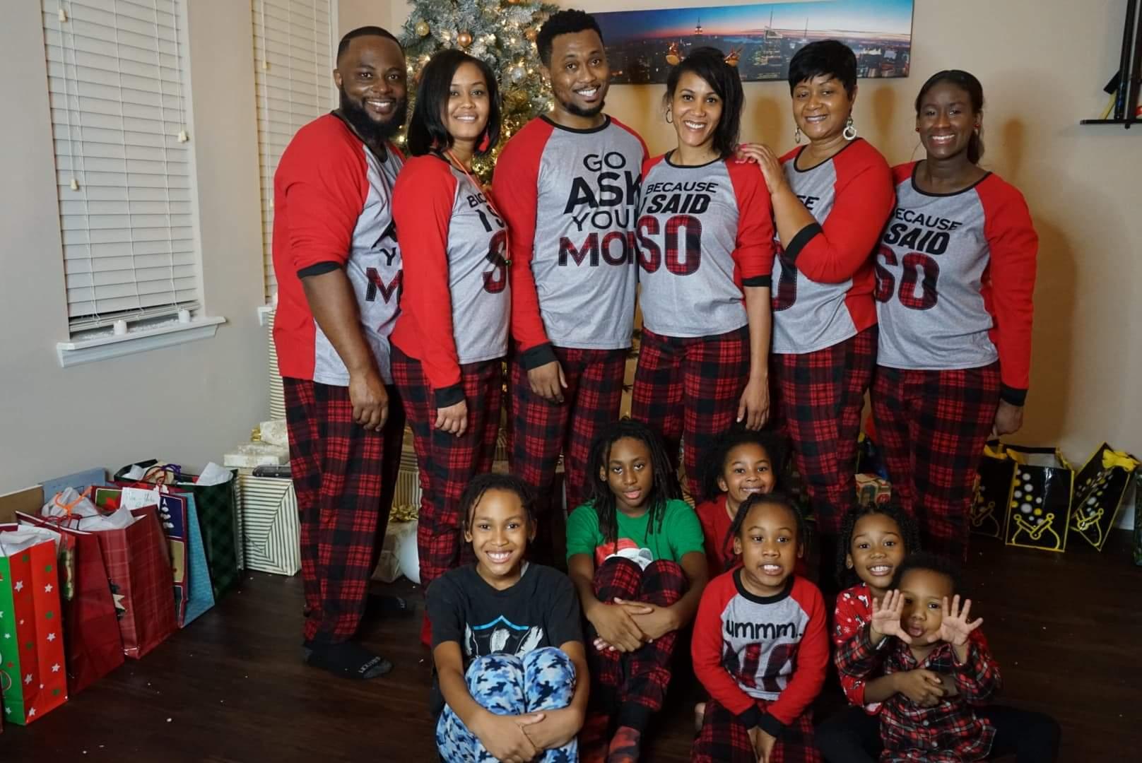 Christina Hall and her family around the Christmas tree