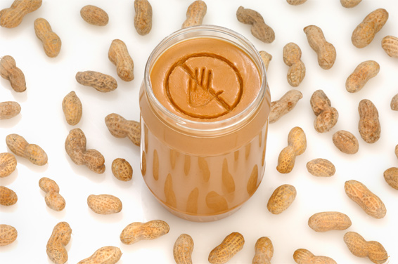 Jar of peanut butter and peanuts