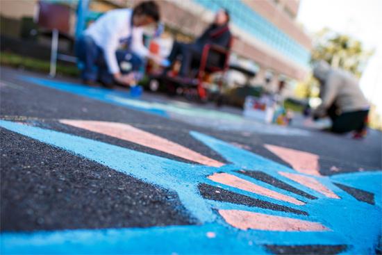 352 Creates event chalking sidewalks
