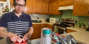 Walfre Lopez uses his artificial-vision system to prepare a meal at his home in Dalton, Georgia. Lopez was the first University of Florida Health patient to receive the Argus II Retinal Prosthesis System during a procedure earlier this year.