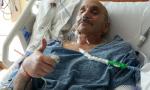Rich Karam lying in a hospital bed at UF Health Shands Cancer Hospital.