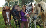 Lisa with four different colored horses