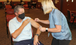 David R. Nelson, M.D., senior vice president for health affairs at UF and president of UF Health, gets his flu vaccine