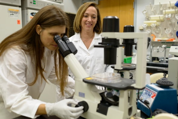 UF Health researchers Stephanie Karst, Ph.D. (right), and Melissa Jones, Ph.D., have discovered how to grow the norovirus in human cells, opening the way to develop antivirals and vaccines.