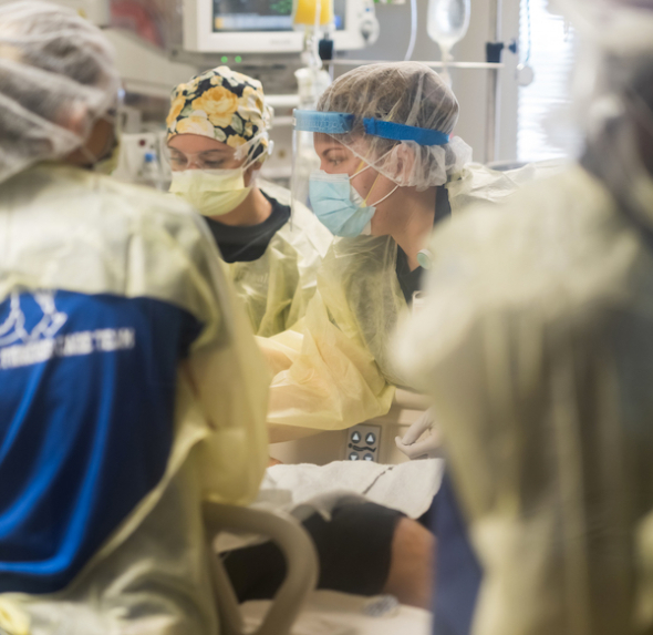 UF Health physicians in an operating room