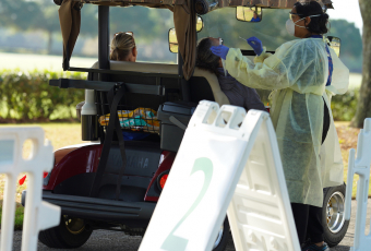 UF Health staff conduct drive-by swabbing for COVID-19 testing
