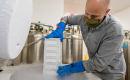 Matthew Schaller, PhD, removes a container of cryopreserved lung tissue from an ultra-cold freezer in his laboratory.